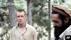IntelCenter shows the Taliban video production of someone who appears to be US soldier Bowe Bergdahl (L). Also with him in this clip appears to be Taliban commander Maulawi Sangin (R), 7 Dec 2010