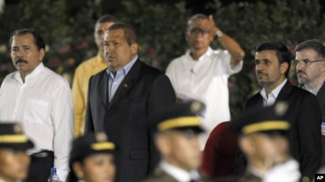 Nicaragua's President Daniel Ortega, left, Venezuela's President Hugo Chavez, second left, Iranian President Mahmoud Ahmadinejad, second right, and Akbar Esmaeil Pour, Iran's ambassador to Nicaragua, right, stand during an honor guard presentation at Orte