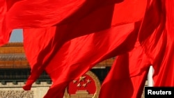 The Great Hall of the People, where the Chinese Communist Party plenum is being held, is seen behinds red flags in Tiananmen square in Beijing November 12, 2013. China's leaders will unveil a reform agenda for the next decade on Tuesday, seeking to balan