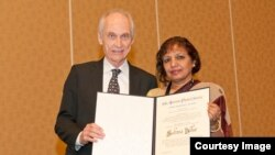 Dr. Sultana Nurun Nahar received John Wheatley award from the American Physical Society. The picture is with the President of APS.jpg