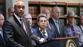 U.S. attorney Robert Capers, left, speaks during a news conference in Brooklyn, N.Y., announcing charges against Mexican drug kingpin Joaquin