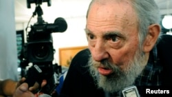 Former Cuban leader Fidel Castro speaks to reporters at a polling station in Havana, February 3, 2013.