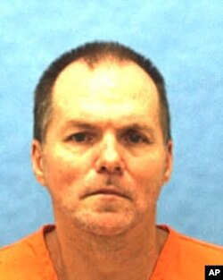 FILE - This undated photo provided by the Florida Department of Corrections shows Mark Asay.