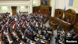 """Lawmakers applaud after scrapping Ukraine's """"non-aligned"""" status during a session of parliament in Kyiv, Dec. 23, 2014."""