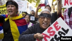 Protesters shout during a pro-Tibet march as Chinese President Xi Jinping