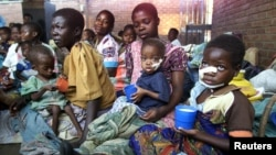 Malnourished Malawian children sit with their mothers at a feeding center at the Zomba Central Hospital 60 km's north of Blantyre (file photo).