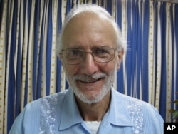 FIILE - In this photo provided by James L. Berenthal, jailed American Alan Gross poses for a photo during a visit by Rabbi Elie Abadie and U.S. lawyer James L. Berenthal in Havana, Cuba, Nov. 27, 2012.