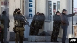 Armed Russian forces arrest Ukrainian army officers during an operation in Simferopol on March 18, 2014.