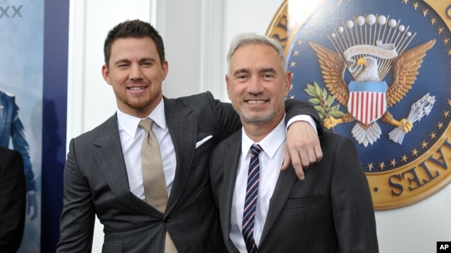 "Actor Channing Tatum, left, and director Roland Emmerich attend the ""White House Down"" premiere at the Ziegfeld Theatre, June 25, 2013 in New York."