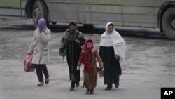 Women walk in Kabul, Afghanistan, on Wednesday, Jan. 4, 2012. The UN says the number of reported violent attacks against Afghan women has more than doubled in a year.