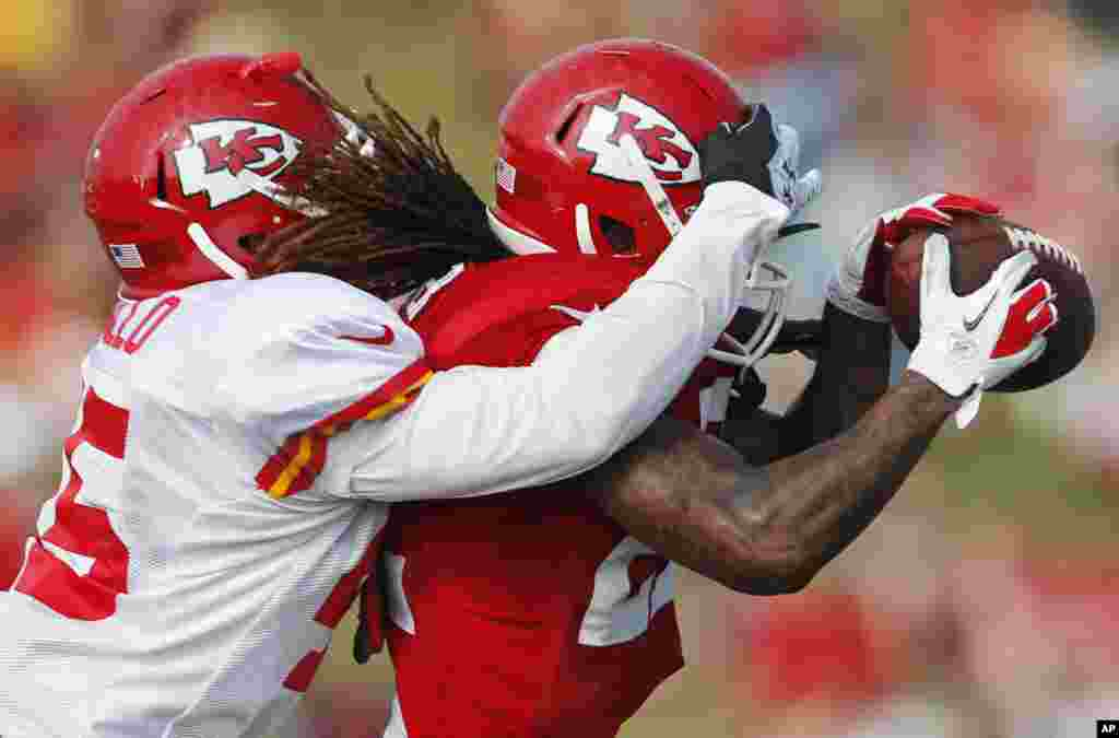 Kansas City Chiefs wide receiver Dexter McCluster (22) makes a catch while covered by defensive back Greg Castillo (45) during NFL football training camp in St. Joseph, Missouri, USA.