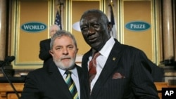 Former President of Ghana, John Agyekum Kufuor, right, and Former President of Brazil, Luiz Inacio Lula Da Silva, dual recipients of the 2011 World Food Prize Laureate, pause for a photo during the World Food Prize ceremony at the Capitol in Des Moines, I