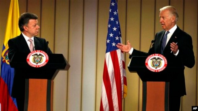 Vice President Joe Biden, right, speaks during a joint press conference with Colombia's President Juan Manuel Santos in Bogota, Colombia May 27, 2013