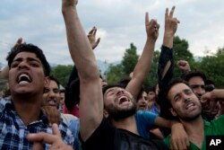 Kashmiri villagers shout slogans during the funeral procession of Burhan Wani, chief of operations of Indian Kashmir's largest rebel group, in Indian-controlled Kashmir, July 9, 2016.
