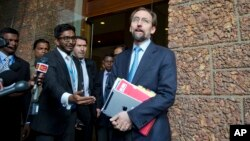 U.N.High Commissioner for Human Rights Zeid Raad al-Hussein, right, speaks to media as he leaves a hotel in Colombo, Sri Lanka, Feb. 6, 2016.