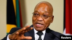 FILE - South Africa's President Jacob Zuma gestures during a media briefing at the Union Building in Pretoria.
