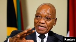 FILE - South Africa's President Jacob Zuma gestures during a media briefing in Pretoria, Nov. 26, 2014.