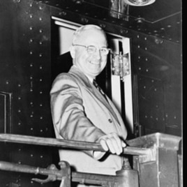 "President Truman on a train, probably during his ""whistle stop"" campaign"