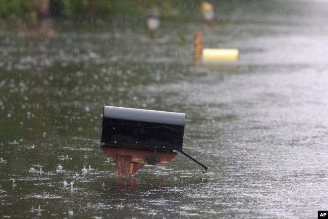 A mailbox on Mill Creek Road is barely above water after Florence hit Newport, N.C., Sept. 15, 2018. A day after blowing ashore, Florence practically parked itself over land all day long and poured on the rain.