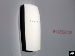 "Tesla's newest product ""Powerwall"" is unveiled on stage in Hawthorne, Calif., April 30, 2015. Tesla CEO Elon Musk is trying to steer his electric car company's technology into homes and businesses as part of an elaborate plan to reshape the power grid with millions of small power plants made of solar panels on roofs and batteries in garages."