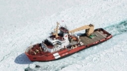 FILE - The Canadian Coast Guard Ship (CCGS) Samuel Risley, an icrebreaker, is shown in this aerial photo near Whitefish Bay on Lake Superior northwest of Sault Ste. Marie, Ontario, April 7, 2015.