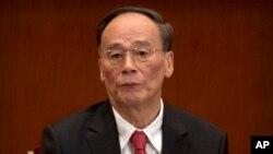 2017年10月18日,中纪委书记和政治局常委王岐山在中国共产党第十九次全国代表大会开幕式上。
