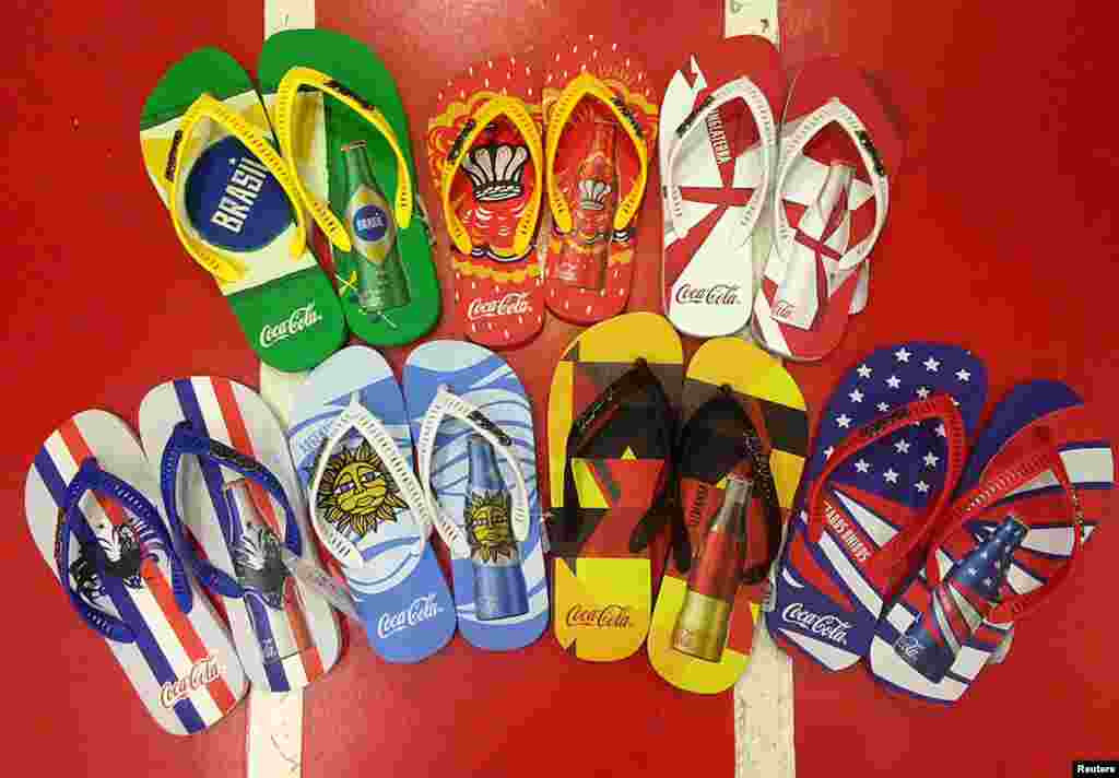 Flip-flops printed with the national flags of soccer teams are sold in a sports shop, in Rio de Janeiro, June 10, 2014.