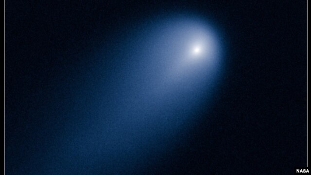 NASA's Hubble Space Telescope provides a close-up look of Comet ISON (C/2012 S1), as photographed on April 10, 2013, when the comet was slightly closer than Jupiter's orbit at a distance of 386 million miles from the sun.