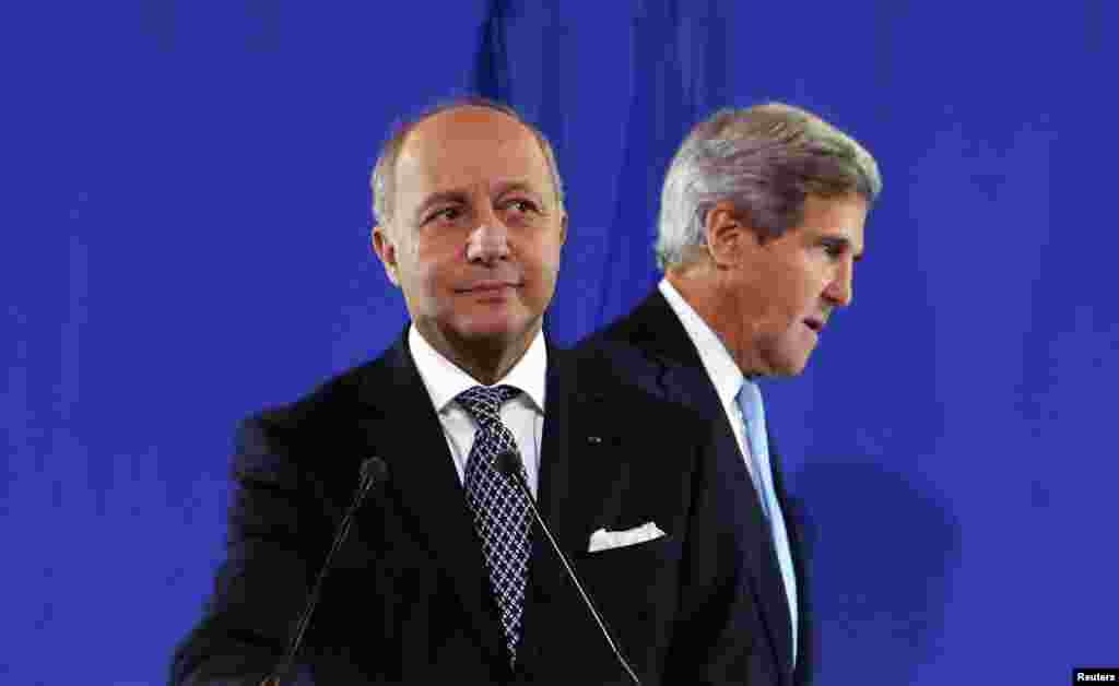 U.S. Secretary of State John Kerry (R) joins French Foreign Minister Laurent Fabius at a news conference after a meeting regarding Syria, at the Quai d'Orsay in Paris, France.