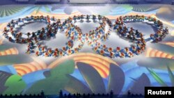 FILE - Performers take part in the closing ceremony of the 2016 Rio Olympics in Rio de Janeiro, Brazil, Aug. 21, 2016.