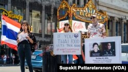 Members of the Thai Rights Now movement hold placards during the 7th anniversary of Thailand's coup rally at Hollywood Walk of Fame, Los Angeles, CA. May 22, 2021