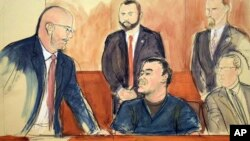 "In this courtroom drawing, Joaquin ""El Chapo"" Guzman, center, speaks to his attorney, Eduardo Balarezo, Feb. 15, 2018, in New York."