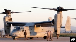 FILE - U.S. Marine officers work next to an MV-22 Osprey VTOL aircraft at the Sigonella airbase, Sicily, March 24, 2011. The Pentagon is looking for a new generation of such planes.