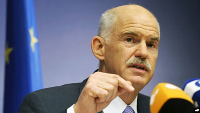 Greece's PM George Papandreou addresses a news conference at the end of an European Union leaders summit in Brussels, June 24, 2011