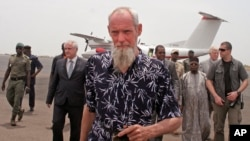 Released Dutch hostage Sjaak Rijke walks on the runway after arriving by airplane in Bamako, April 7, 2015.