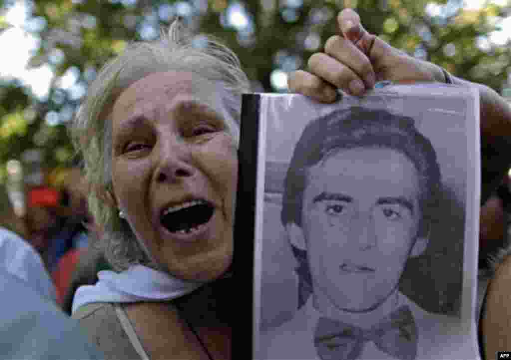 Pepa Pussek holds a picture of her son Juan Carlos Galvan, one of the victims killed during Argentina's dirty war, as she listens to the sentence for former dictator Jorge Videla in Cordoba, Argentina, Wednesday Dec. 22, 2010. Videla was sentenced to lif