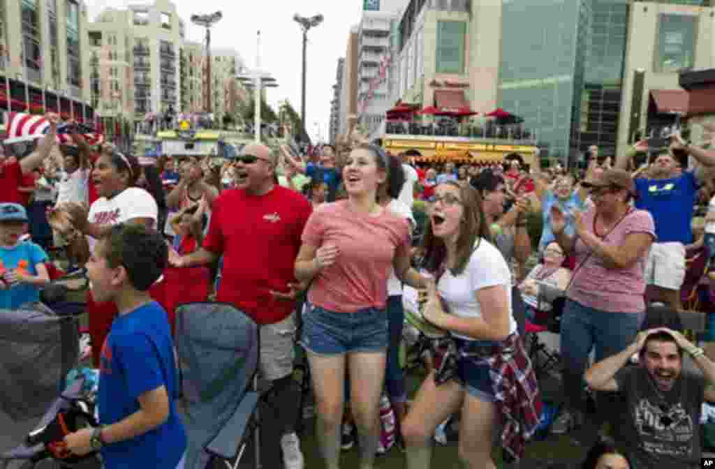 Fans celebrate after the United States scored their third goal against Japan during the first half of the FIFA Women's World Cup soccer championship, National Harbor, Maryland, July 5, 2015.