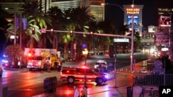 Police and emergency crews respond to the scene of a car accident along Las Vegas Boulevard, Sunday, Dec. 20, 2015.