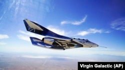 In this May 29, 2018 photo provided by Virgin Galactic, the VSS Unity craft flies during a supersonic flight test.