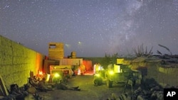 US Marines lie down inside a small patrol base during a pause in an all night mission in Helmand province, southern Afghanistan, October 2009. (file photo)