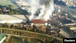 A general view from helicopter shows a large fire that has broken out in a municipal rubbish dump on the northern outskirts of Rome, Italy, Dec. 11, 2018. (Vigili del Fuoco)