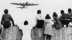 West Berlin children at Tempelhof airport watch American airplanes bringing in supplies