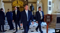 House Speaker John Boehner walks back to his office on Capitol Hill in Washington, Jan. 14, 2015.