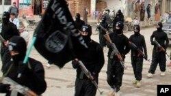 Combattants du groupe Etat Islamique à Raqqa en Syrie.