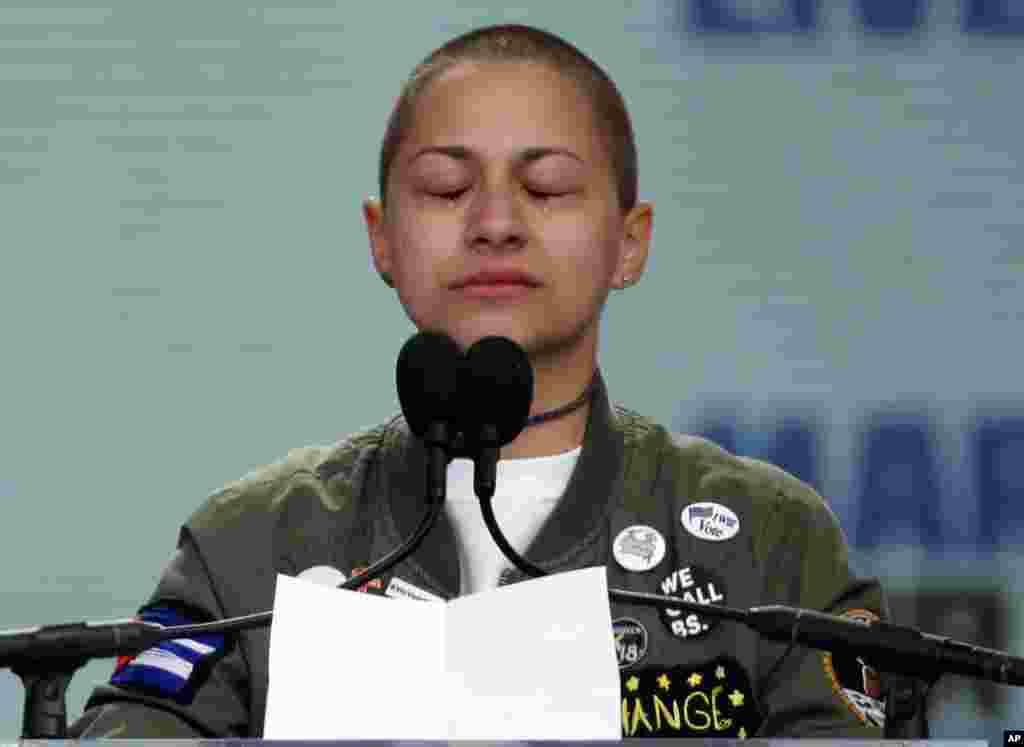 "Emma Gonzalez, a survivor of the mass shooting at Marjory Stoneman Douglas High School in Parkland, Fla., closes her eyes and cries as she stands silently at the podium for the amount of time it took the Parkland shooter to go on his killing spree during the ""March for Our Lives"" rally in support of gun control in Washington, Saturday, March 24, 2018. (AP Photo/Alex Brandon)"
