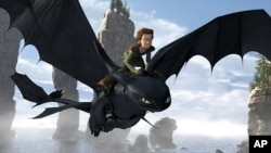 "Toothless, a Night Fury Dragon – the rarest of all kind – soars through the sky with Hiccup (Jay Baruchel) on his back in a scene from ""How to Train Your Dragon"""