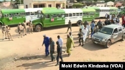 Buses transporting ex-militants enter Banki, Nigeria from Cameroon, Sept. 18, 2021.