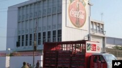 A truck leaves a Coca-Cola factory to distribute its bevarages to shops and restaurants in Phnom Penh, file photo.