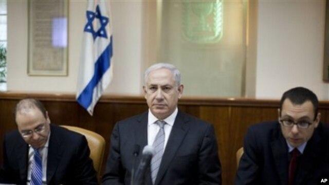 Israeli Prime Minister Benjamin Netanyahu, center, convenes the weekly cabinet meeting in Jerusalem, March 6, 2011