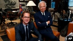Designer Ralph Lauren (r) poses in his office accompanied by Stefan Larsson, global president of Old Navy, Sept. 29, 2015, in New York.